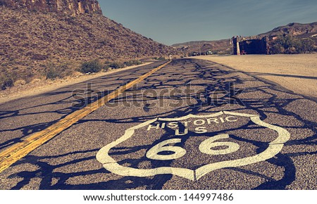 Route 66 Vintage - vertical image of route 66 road leading towards the distant horizon. - stock photo