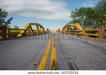Route 66:  William H. Murray Bridge, a.k.a. Pony Truss Bridge, over the S. Canadian River, near Geary-Hinton, Oklahoma. - stock photo