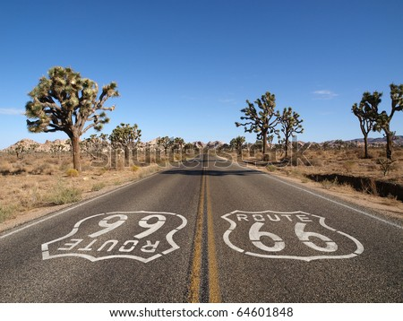 Route 66 with Joshua Trees deep inside California's Mojave Desert. - stock photo