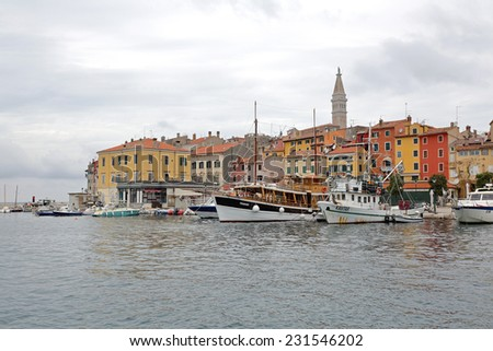 ROVINJ, CROATIA - OCTOBER 15: Town and port in Rovinj on OCTOBER 15, 2014. Colorful houses at seafront with boats in Rovinj, Croatia.