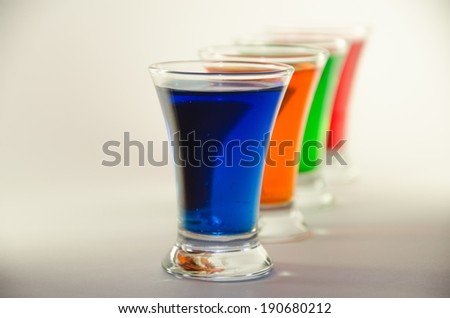 Row colored alcoholic cocktail glass closeup, fruit drinks in glass containers - stock photo