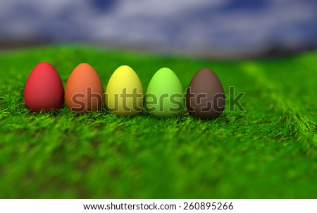 Row colored eggs on grass