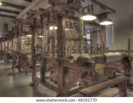 Row of a number of damask weaving machines - stock photo