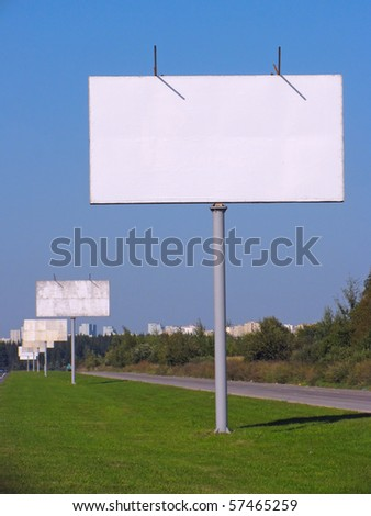 Row of advertising boards with blank space - roadside