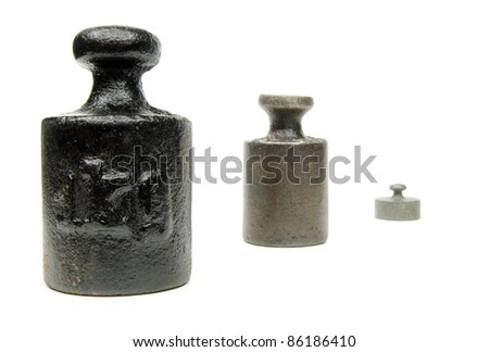 row of apothecaries' weights - stock photo