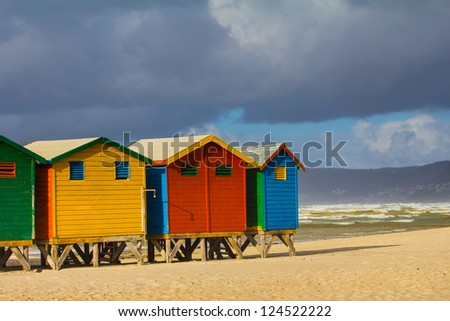 Row of beach huts at Muizenberg beach, Cape Town, South Africa - stock photo