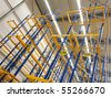 Row of big and empty warehouse selves - stock photo