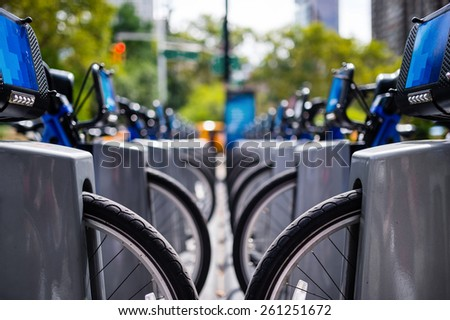 Row of bikes to rent in the city - stock photo