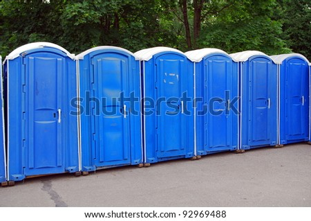 Row of blue public toilets in Moscow park - stock photo