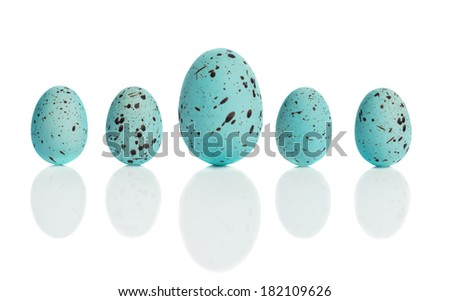 Row of blue speckled Easter eggs with drop shadow - stock photo