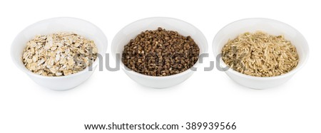 Row of bowls with oats, buckwheat and brown rice isolated on white background - stock photo