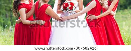 Row of bridesmaids  at wedding ceremony. Bride and bridesmaids - stock photo