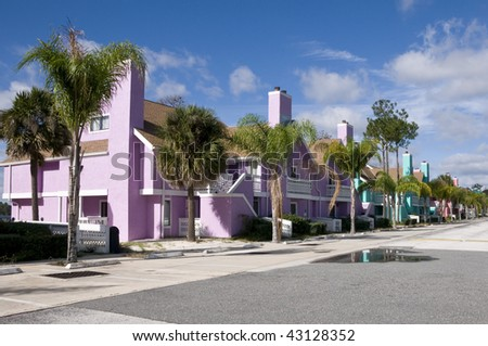 Row of Brightly colored Abandon condominiums due to recession - stock photo