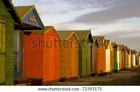 Row of brightly coloured beach huts along the Essex coast at Brightlingsea, United Kingdom.