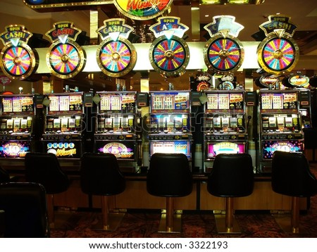 row of brightly lite slot machines - stock photo