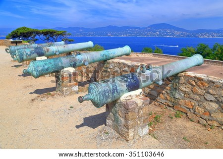 Row of bronze canons set to defend the fortress of Saint Tropez, French Riviera, France - stock photo