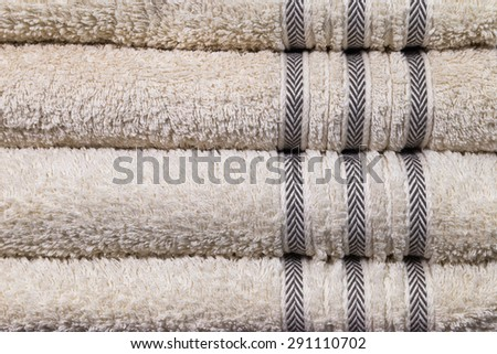 Row of brown towels - stock photo
