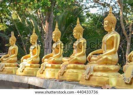 row of Buddha statues in Koh Phayam, Thailand - stock photo