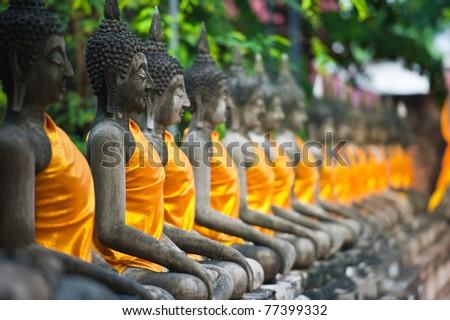 Row of Buddha Status at Wat Yai Chaimongkol, Ayutthaya, Thailand - stock photo