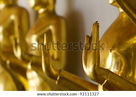 row of buddhas statue in Thailand (shallow dept of field) - stock photo