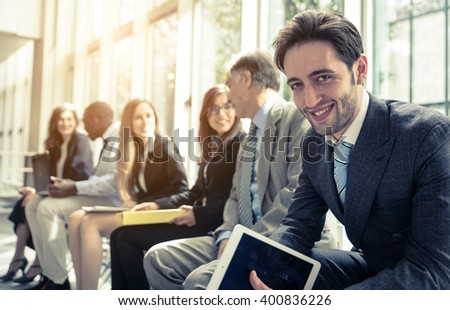 Row of business people waiting for an interview. Concept about business and professions - stock photo