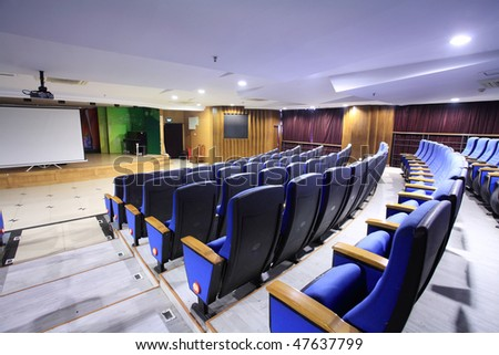 row of chair in theater interior