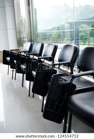 Row of chairs in boardroom. - stock photo