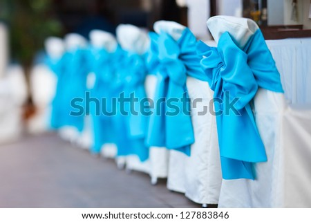 Row of chairs tastefully decorated for a part event - stock photo