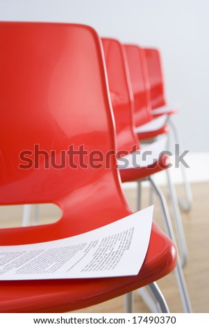 Row Of Chairs With Documents - stock photo