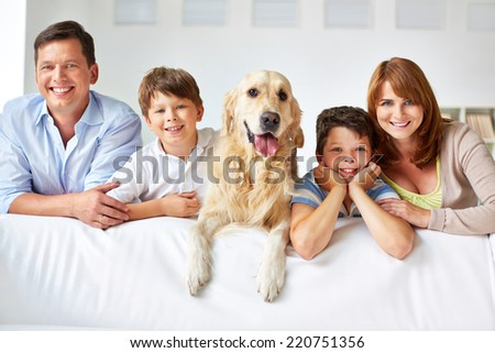 Row of cheerful family members at home