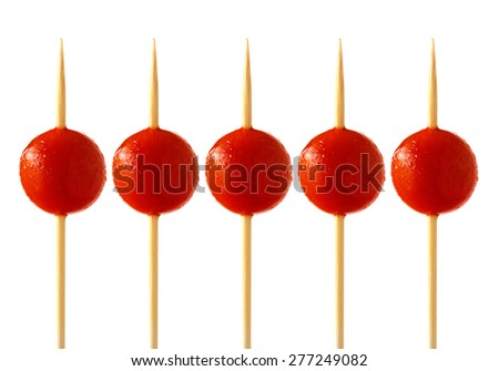 Row of cherry tomatoes on skewers - stock photo