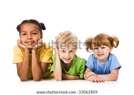 Row of children smiling and resting together - stock photo