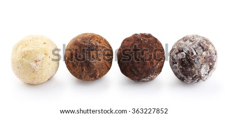 Row of chocolate truffles, isolated on white - stock photo