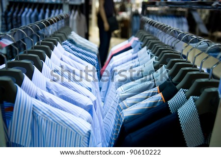 row of cloth hangers with shirts - stock photo