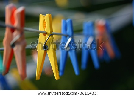 row of clothespins - stock photo