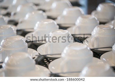 Row of coffee cups with spoon - stock photo