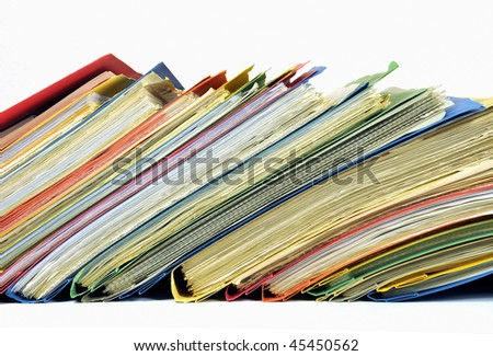 Row of colored folders with documents isolated on white - stock photo