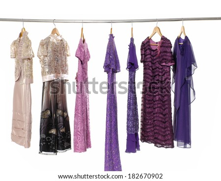 Row of colorful female fashion clothing on hanging