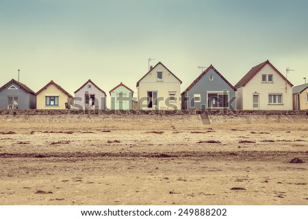 row of colorful houses on the beach. cotentin. normandy. france. - stock photo