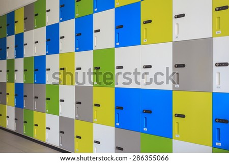 row of colorful lockers and security password code on door for safety concept - stock photo