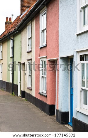 Row of colorful small cottages in Diss, England - stock photo