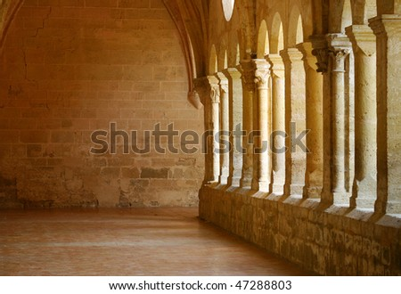 row of columns in an old Church - stock photo