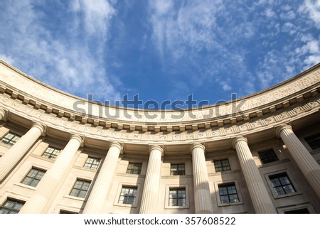 Row of columns rising to the blue sky. Ronald Reagan building and Woodrow Wilson Plaza. Washington DC. Place for copy - stock photo