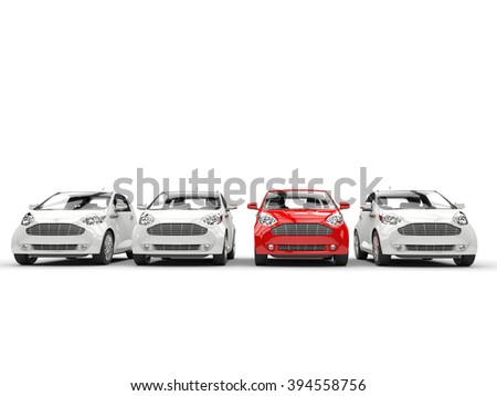Row of compact cars - red stands out - stock photo