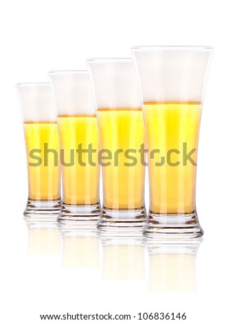 row of dark beer Bottles isolated on a white background