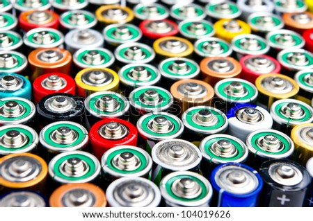 Row of different types batteries - stock photo