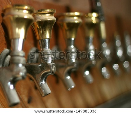 Row of dusty old beer taps in an abandoned bar - stock photo