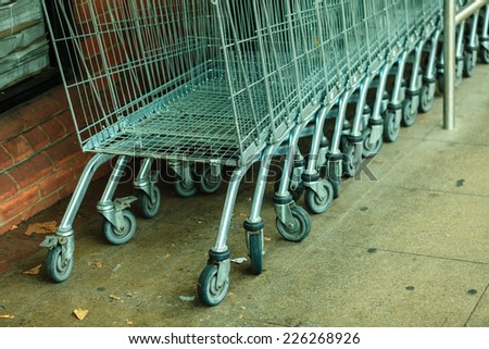 Row of empty shopping cart trolley. Market grocery shop and retail concept. Outdoor. - stock photo