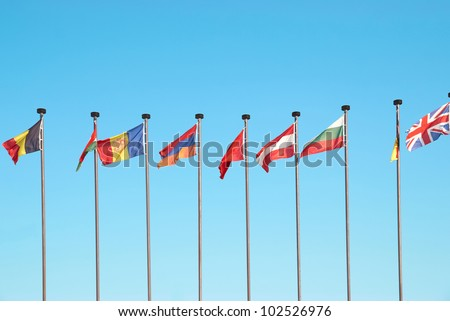 Row of european flags against blue sky background - stock photo