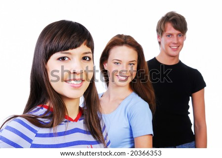 Row of face of three young smiling teens on white